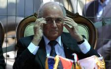 FIFA president Joseph Blatter adjusts his glasses as he speaks to the press during his visit to the sports club in the village of Dura al-Qaraa, near the West Bank city of Ramallah, on 20 May, 2015. Picture: AFP.