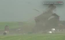 Screengrab from footage of a tornado ripping through a barn.