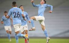 Manchester City midfielder Phil Foden (R) celebrates scoring his team's first goal with teammates during the English Premier League football match between Manchester City and Brighton and Hove Albion at the Etihad Stadium in Manchester, north west England, on January 13, 2021. Picture: Clive Brunskill/AFP