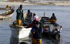 Fishermen prepare to leave the local fishing port of Charca aFishermen prepare to leave the local fishing port of Charca Nouadhibou. Picture: AFP/Seyllou Diallo.Nouadibou. Picture: AFP/Seyllou Diallo.