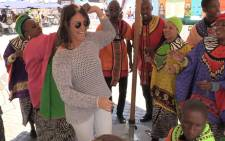 The Soweto Gospel Choir serenades a woman in Johannesburg, the group collaborated with technology company Uber to celebrate Heritage Day, Wednesday 24 September 2014. Picture: Vumani Mkhize/EWN.