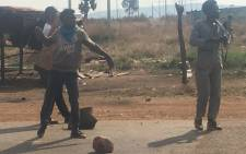 People protest in Finetown over housing. They threw rocks at the police. Picture: EWN.