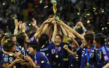 Japan's players celebrate with the trophy after the FIFA Women's Football World Cup final match vs USA on 17 July 2011. Picture: AFP