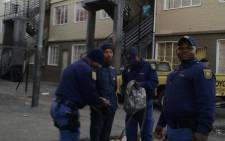 Police & soldiers descended on Manenberg during Operation Fiela to search for illegal goods, weapons and drugs on 21 May 2015. Picture:@SAPoliceService