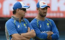 FILE: Australian cricketer Glenn Maxwell (R) speaks with team selector Mark Waugh during a training session at the Holkar Stadium in Indore on 23 September 2017. Picture: AFP