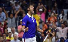 FILE: World number 1 Novak Djokovic claimed his 10th grand slam title after winning the 2015 US Open on 13 September 2015. Picture: AFP