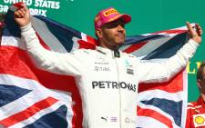 Race winner Lewis Hamilton of Great Britain and Mercedes GP celebrates on the podium during the United States Formula One Grand Prix at Circuit of The Americas on 22 October, 2017 in Austin, Texas. Picture: AFP.
