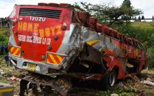 Emergency personnel and security forces inspect the wreckage of a bus at the site of an accident in Kericho, western Kenya, on 10 October 2018. Picture: AFP.
