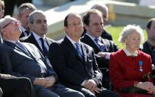 French President Francois Hollande sits during a French D-Day commemoration ceremony at the World War II memorial in Caen, Normandy, on 6 June 2014, marking the 70th anniversary of the World War II Allied landings in Normandy. Picture: AFP.