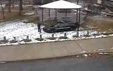 This video grab from a surveillance video released by the Cleveland Police Department on 26 November 2014 shows Cleveland police officers aiming at Tamir Rice, the 12-year-old boy, who was fatally shot at the recreation centre. The video shows the youth was shot within seconds of the police officer's arrival. Tamir Rice, who is African American, died on 23 November. Picture: AFP.