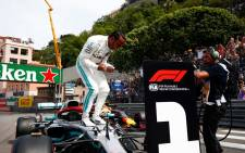 FILE: Mercedes driver Lewis Hamilton celebrates his pole position for the 2019 Monaco Grand Prix on 25 May 2019. Picture: @MercedesAMGF1/Twitter