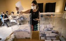 A woman prepares to cast her ballot during Morocco's parliamentary and local elections in the capital Rabat on September 8, 2021. Picture: FADEL SENNA / AFP