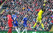 Chelsea's Belgian goalkeeper Thibaut Courtois (R) catches the ball during the English Premier League football match between Liverpool and Chelsea at Anfield in Liverpool. Picture: AFP.