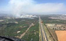 Earlier the blaze forced the closure of a section of the N2 due to poor visibility caused by the smoke. Picture: Working on Fire ‏@wo_fire.