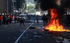FILE PICTURE: Protesters burn bins during a municipal workers protest in Cape Town, on 16 August 2011. Picture: Sapa