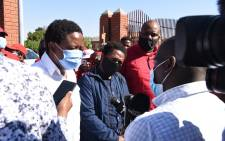 Economic Freedom Fighters (EFF) leader Julius Malema (L) and EFF MP Mbuyiseni Ndlozi (C) talk to the media after appearing at the Randburg Magistrates Court on 14 September 2020. Picture: @EFFSouthAfrica/Twitter