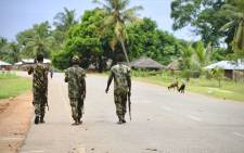 FILE: Soldiers from the Mozambican army patrol the streets after security in the area was increased, following a two-day attack from suspected islamists in October last year, on 7 March 2018 in Mocimboa da Praia, Mozambique. Picture: AFP