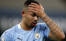 Manchester City striker Gabriel Jesus holds his head after a challenge during the English Premier League football match between Manchester City and West Bromwich Albion at the Etihad Stadium in Manchester, north west England, on 15 December 2020. Picture: AFP