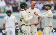 Australia cricketers celebrate during a match against Pakistan on day one of the second test in Melbourne on Monday. Picture: @ICC.