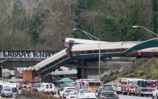 The scene of a portion of the Interstate I-5 highway after an Amtrak high speed train derailed from an overpass on 18 December, 2017 near the city of Tacoma, Washington state. Picture: AFP