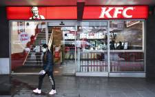 A person walks past a KFC outlet in Melbourne's central business district on 15 July 2020. Picture: AFP
