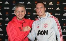 Manchester United caretaker boss Ole Gunnar Solskjaer congratulates Phil Jones after the defender inked a new deal with the club. Picture: www.manutd.com