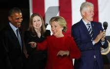 Hillary Clinton stands with President Barack Obama, former President Bill Clinton and daughter Chelsea during an election eve rally on 7 November, 2016 in Philadelphia, Pennsylvania. Picture: AFP.