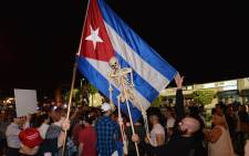 Miami residents celebrate the death of Fidel Castro on 26 November2016 in Miami, Florida. Cuba's current President and younger brother of Fidel, Raul Castro, announced in a brief TV appearance that Fidel Castro had died on 25 November, aged 90. Picture: AFP