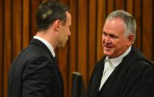Oscar Pistorius with his legal representative Barry Roux at the High Court in Pretoria on 30 June 2014 after spending 30 days under psychiatric observation. Picture: Pool.