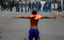 FILE: Opposition activists clash with riot police during a protest against President Nicolas Maduro in Caracas. Picture: AFP.