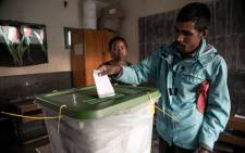 A man casts his ballot at a polling station of Isotry district in Antananarivo on 7 November 2018, during the first round of Madagascar's presidential election. Madagascar went to the polls on 7 November. Picture: AFP.