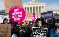 "In this file photo taken on 18 January 2019, pro-choice activists hold signs alongside anti-abortion activists participating in the ""March for Life,"" an annual event to mark the anniversary of the 1973 Supreme Court case Roe v. Wade, which legalized abortion in the US, outside the US Supreme Court in Washington, DC. Picture: AFP"