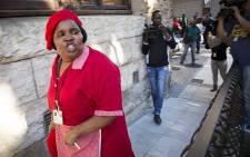 FILE: The EFF's Makoti Khawula retaliates against Parliamentary staff who clashed with MPs outside the National Assembly after the party's members were ejected on 4 May 2016. Picture: Aletta Harrison/EWN.