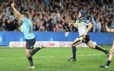 FILE: Waratahs flyhalf Bernard Foley celebrates as he runs in a brilliant break away try against the Brumbies. Picture: Official Waratahs Rugby Facebook Page.