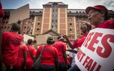 EFF members sing and dance outside the Pretoria High Court during President Jacob Zuma's bid to interdict the release of the State Capture report. Picture: Thomas Holder/EWN.