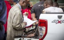 Suspects involved in a shooting on Katherine Street near Grayston Drive are questioned by police. Picture: Thomas Holder/EWN