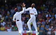 West Indies Roston Chase and teammate celebrate a wicket during their clash with England. Picture: @windiescricket/Twitter.