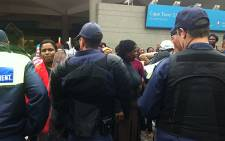FILE: Khayelitsha residents were stopped by police at Cape Town Train Station after they were found carrying containers of raw sewage. Picture: Shamiela Fisher/EWN