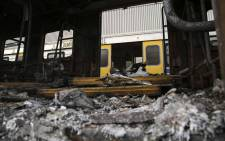 Five carriages caught alight at Retreat Station on Thursday 27 July 2018. Picture: Cindy Archillies/EWN