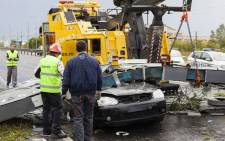 The car driven by a 24-year-old man who was killed after the city gate fell on the car he was driving, following wind gusts in Timisoara city September 17, 2017. Picture: AFP.
