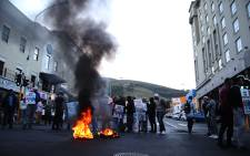 Bo-Kaap residents protest against the city's proposed plans to develop the historic community, calling instead for the iconic neighbourhood to be preserved. Picture: Bertram Malgas/EWN