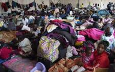FILE: One part of a group of about 630 people, refugees originally from Democratic Republic of Congo, Rwanda, Burundi, and Bangladesh, and other countries who are sleeping in a large tent in Bellville, Cape Town, on 22 September 2020. Picture: AFP