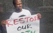 A member of the Climate Justice Action Group pickets outside the Gauteng Agriculture and Rural Development's offices in Marshalltown, Johannesburg on 22 April 2021. Picture: @Earthlife_JHB/Twitter