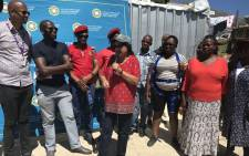 Cape Town mayor Patricia de Lille in Imizamo Yethu to switch on power in Disa and Pipetrack, temporary relocation areas for families affected by the March fire. Picture: Monique Mortlock/EWN.