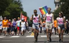 Demonstrators carry signs during the Equality March for Unity and Peace on June 11, 2017 in Washington, D.C. Thousands around the country participated in marches for the LGBTQ communities, the central march taking place in Washington. Picture: AFP.