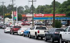 Motorists wait in line to refuel at a Circle K gas station on 12 May 2021 in Fayetteville, North Carolina. Most stations in the area along I-95 are without fuel following the Colonial Pipeline hack. The 5,500 mile long pipeline delivers a large percentage of fuel on the East Coast from Texas up to New York. Picture: SEAN RAYFORD/AFP