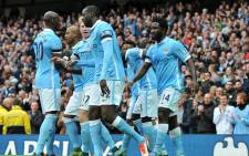 Manchester City players celebrate with Kevin De Bruyne after scoring a minute into stoppage time to give them a 2-1 win over Sevilla at the Etihad Stadium in Group D on 21 October 2015. Picture: Manchester City Facebook page.