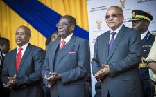 South African President Jacob Zuma and Zimbabwean President Robert Mugabe made their way through the University of Fort Hare sports complex and onto stage to the singing and cheering of the audience. Picture: Thomas Holder/EWN.