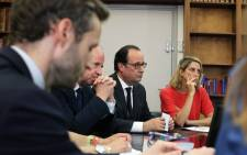 French Minister of Justice Jean-Jacques Urvoas (2nd L) and France's President Francois Hollande (2nd R), look on during a meeting with magistrates, at the Justice Minister, in Paris, on 18 July 2016. Picture: AFP.