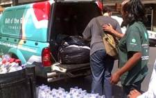 Gift of the Givers employees deliver food parcels and water to the Central Methodist Church in the Johannesburg city centre. Picture: Micel Schnehage/Eyewitness News